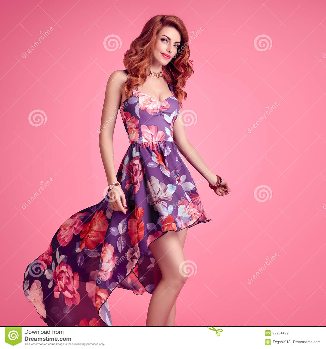 af2d1b851 Sensual Redhead woman in Fashion Trendy Floral summer Dress Smiling. Beauty  Model in fashion pose. Stylish Curly Wavy hairstyle