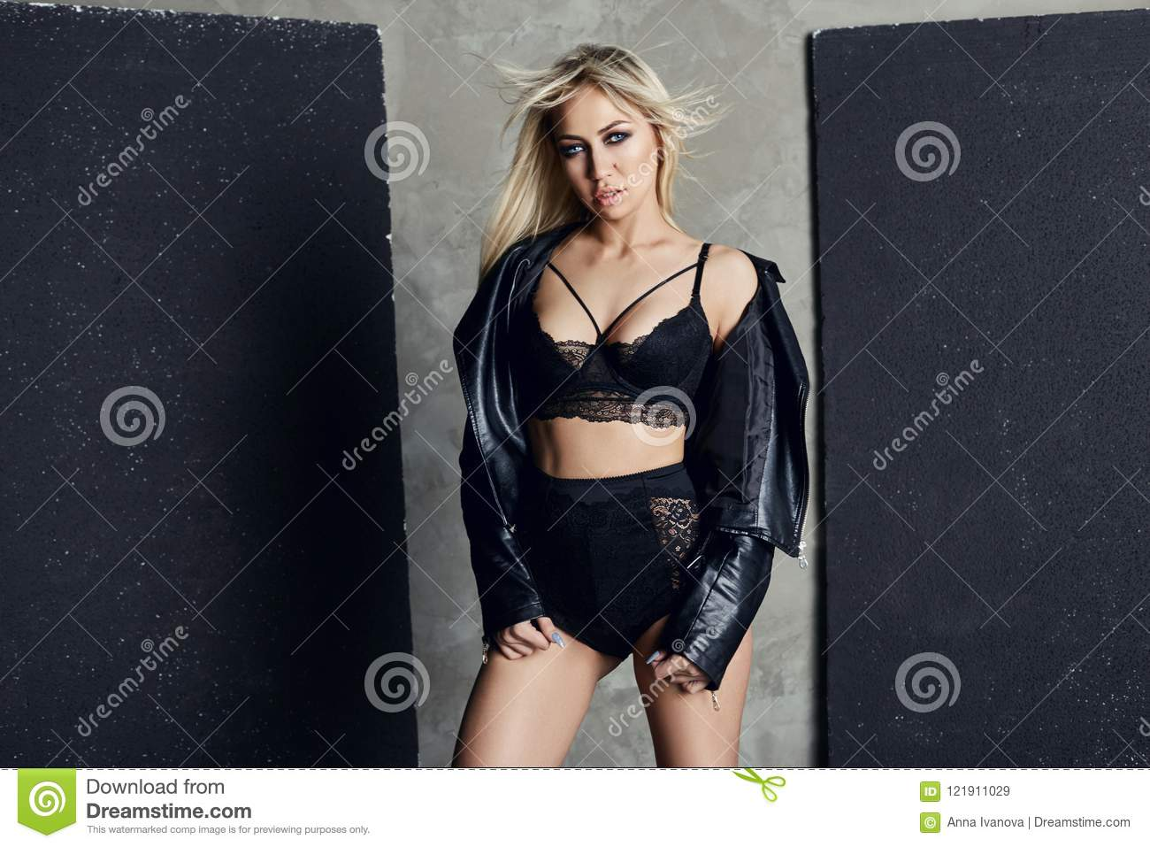 Fashion Blonde In Black Underwear And A Leather Jacket Stan Stock
