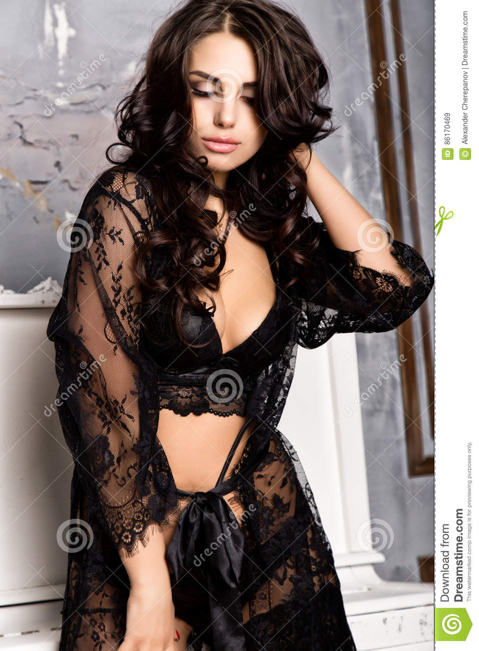 c325b26890e Fashion young woman in black lacy lingerie and stockings posing on piano