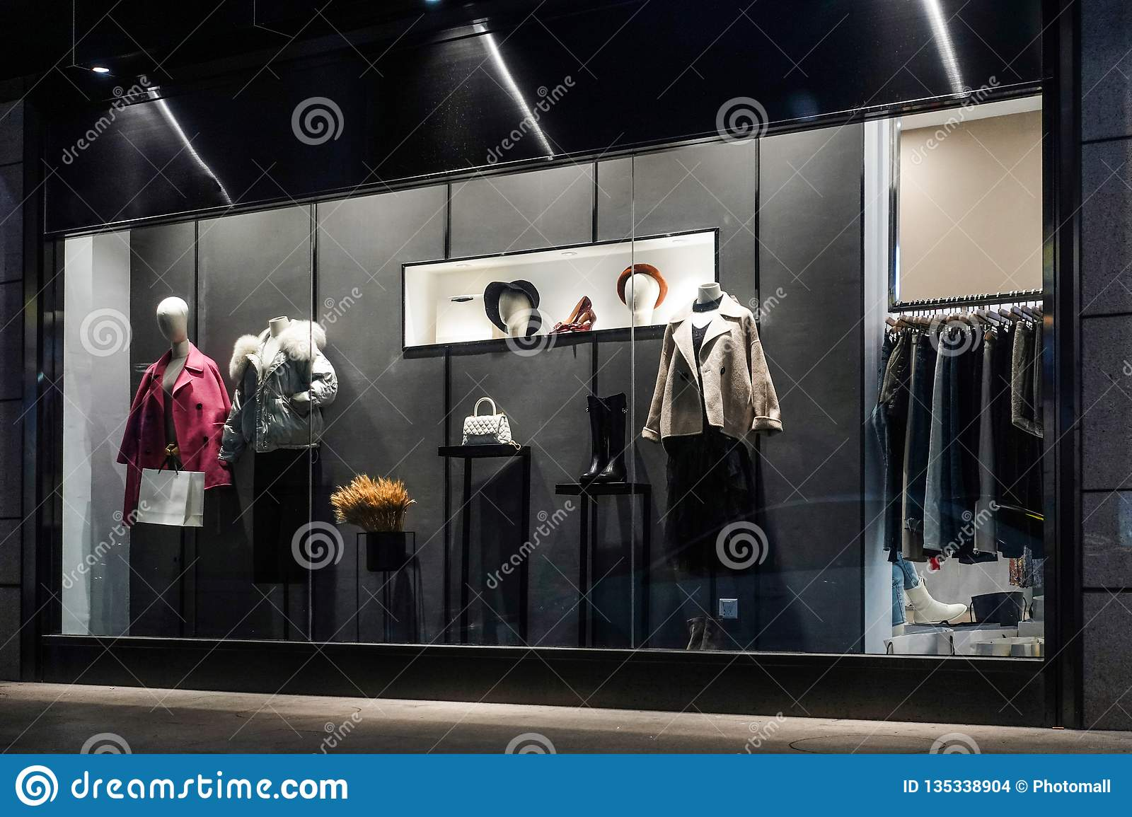 9ad708f1cb419 View of womens fashion clothing store front, Woman mannequin in fashion  clothing retail shop window.