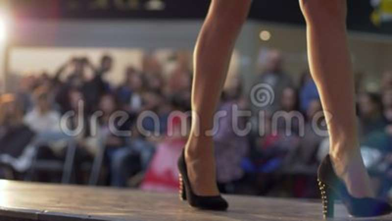 03a50a1cfbc8 Fashion Show, Model Legs Goes To Podium In High-heeled Shoes In Short Dress  On Background Of Light And Audience Stock Footage - Video of light, footwear:  ...