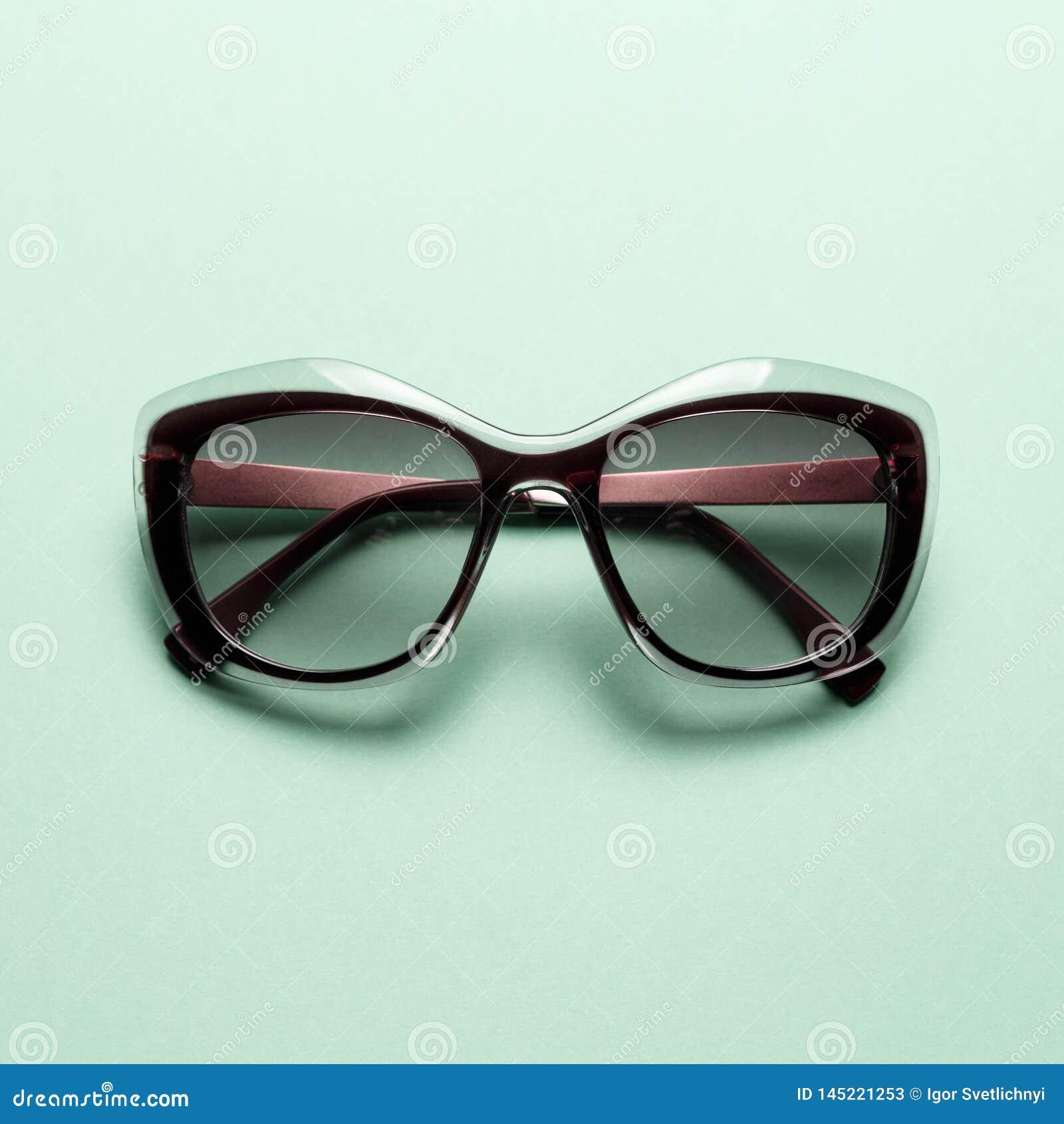 Fashion sunglasses on Mint background
