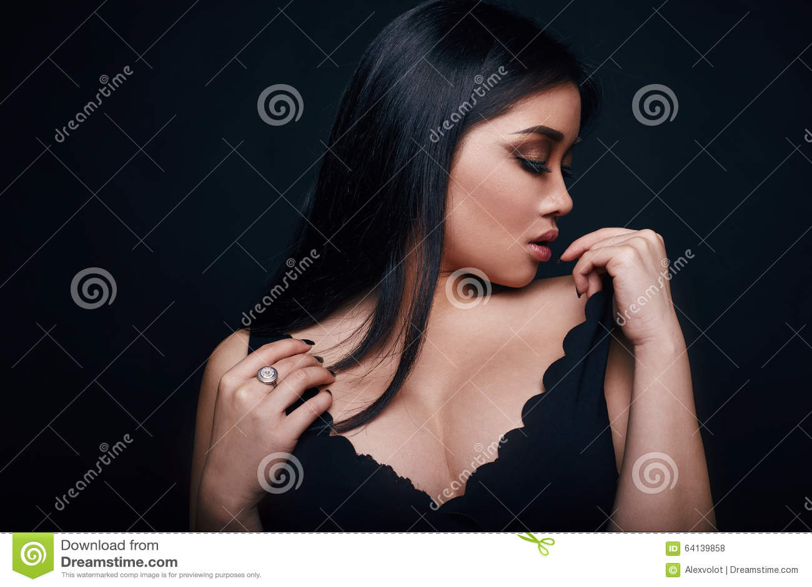 df6cc943457b Fashion swag portrait of beautiful elegant asian woman in formal dress on black  background