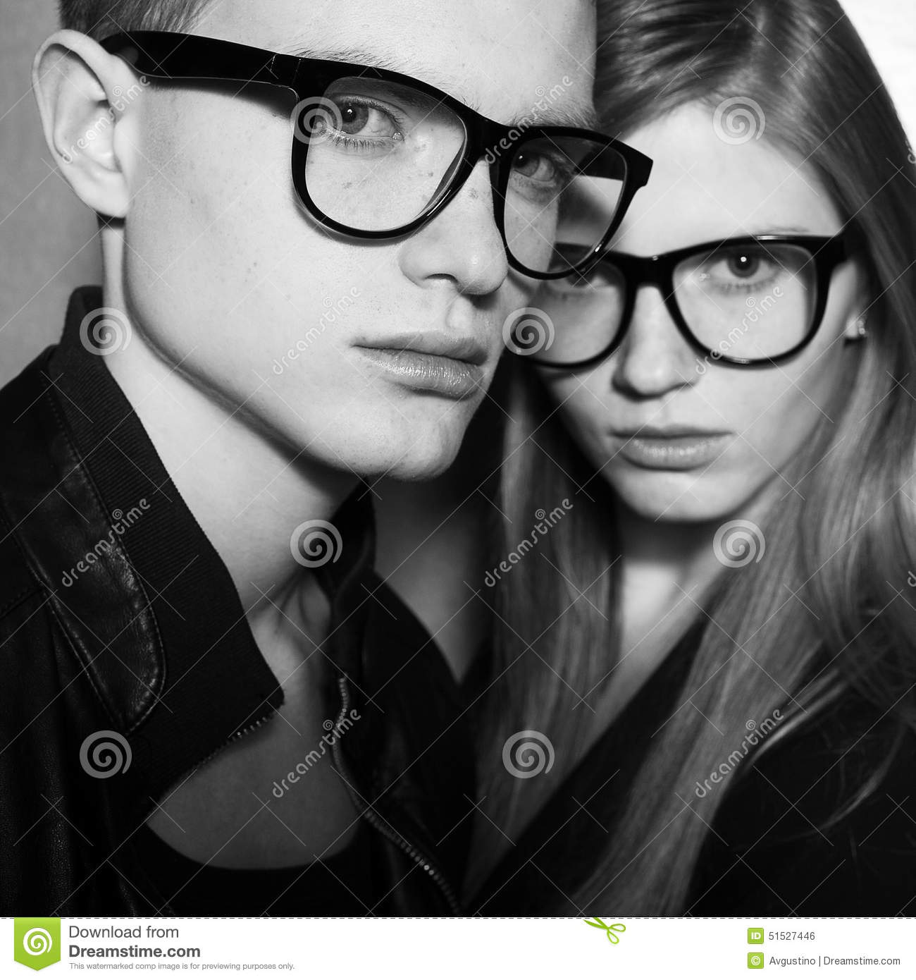 eyewear fashion  Fashion Twins In Black Clothes And Trendy Eyewear Stock Photo ...