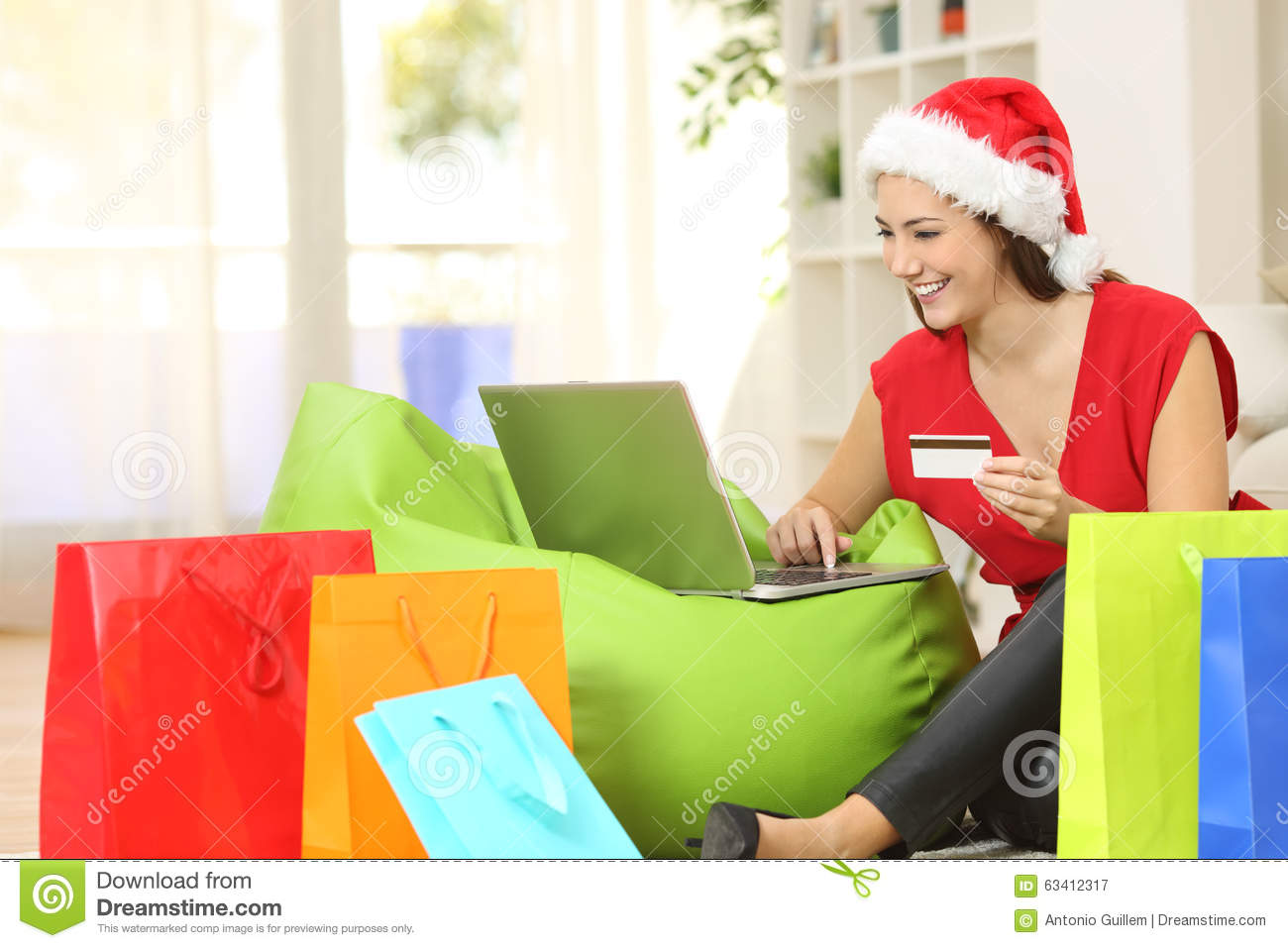 Fashion woman buying online for christmas stock photo for Online shopping for the home