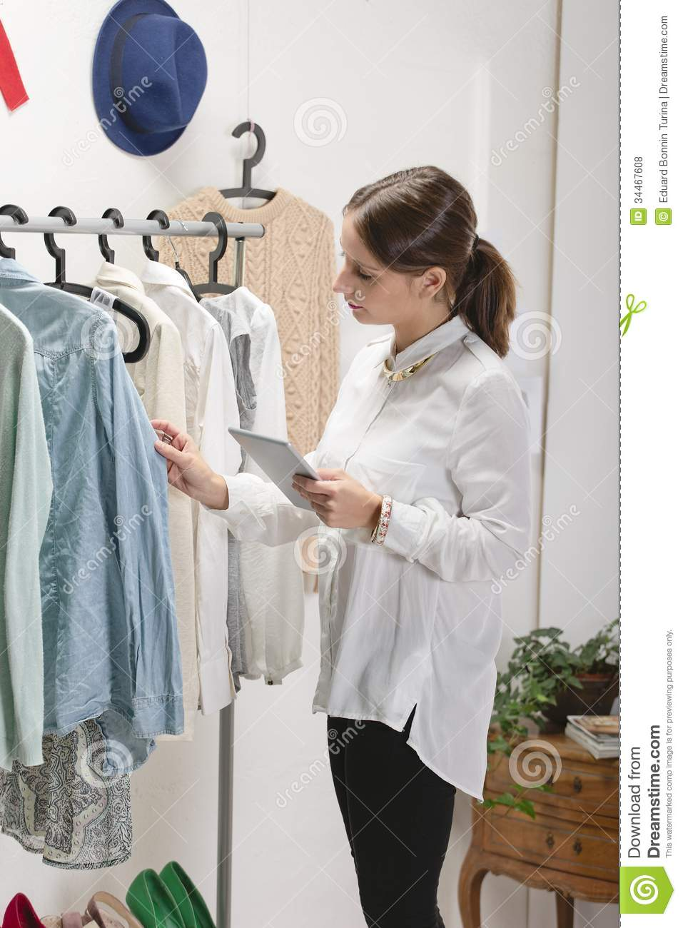 Fashion woman choosing a piece for the new collection with digit
