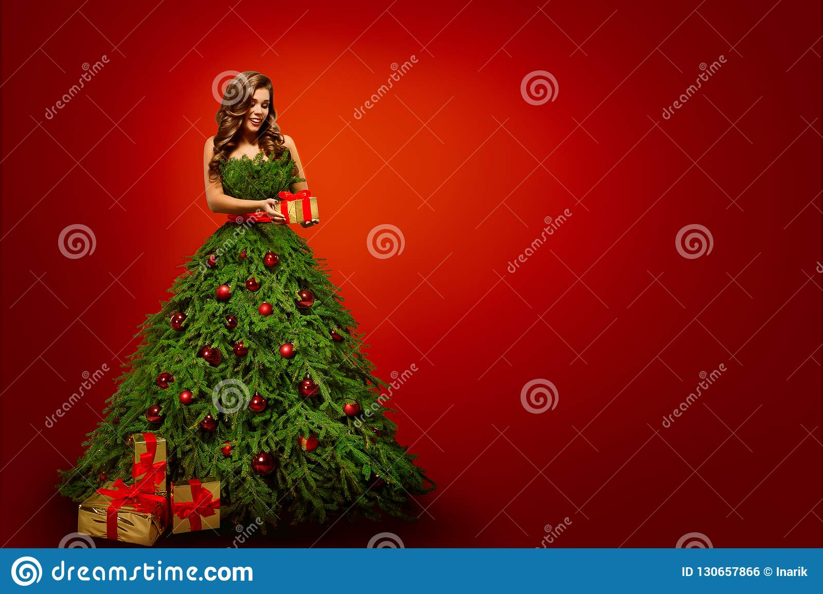 Fashion Woman in Christmas Tree Dress, Model hold Xmas Present