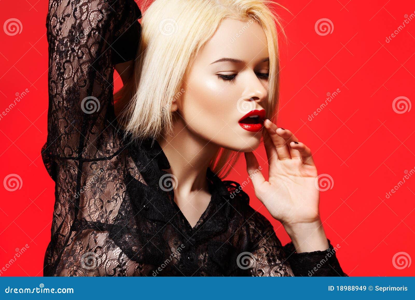 Fashion woman in dynamic model pose, lace shirt
