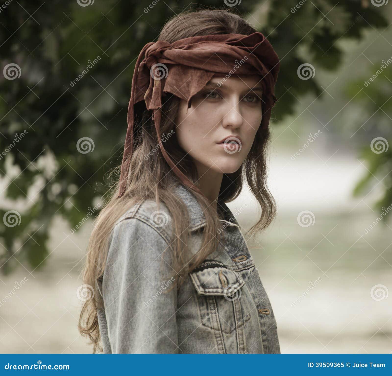 Fashion woman posing in summer park