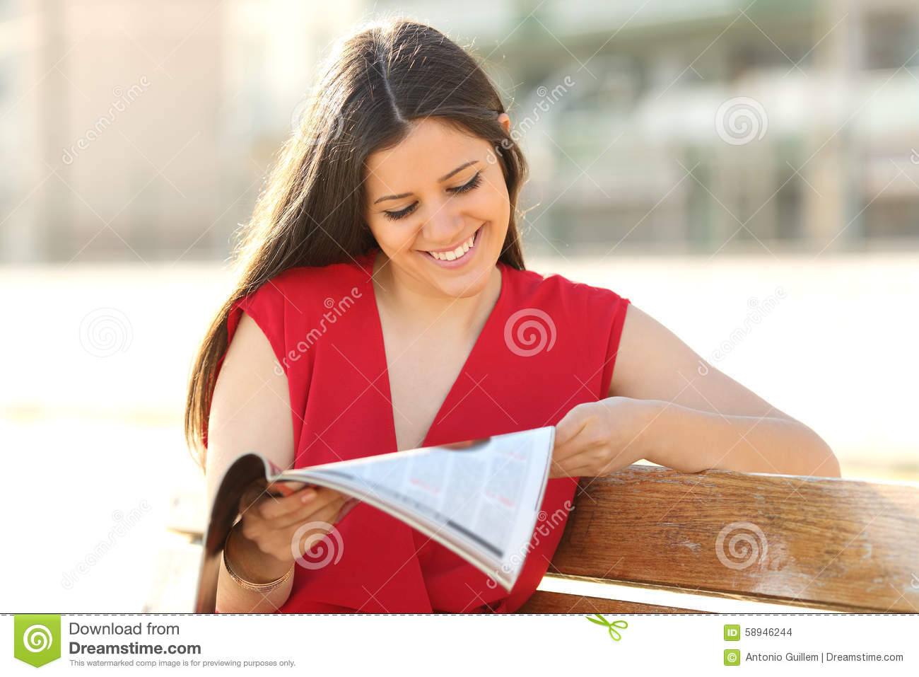 fashion woman reading a magazine in a park stock photo image 58946244