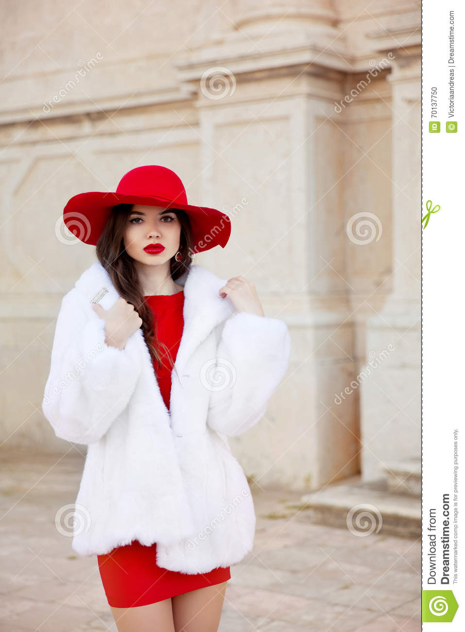 Fashion Woman In Red Hat And Dress Wearing White Fur Coat. Elega ...