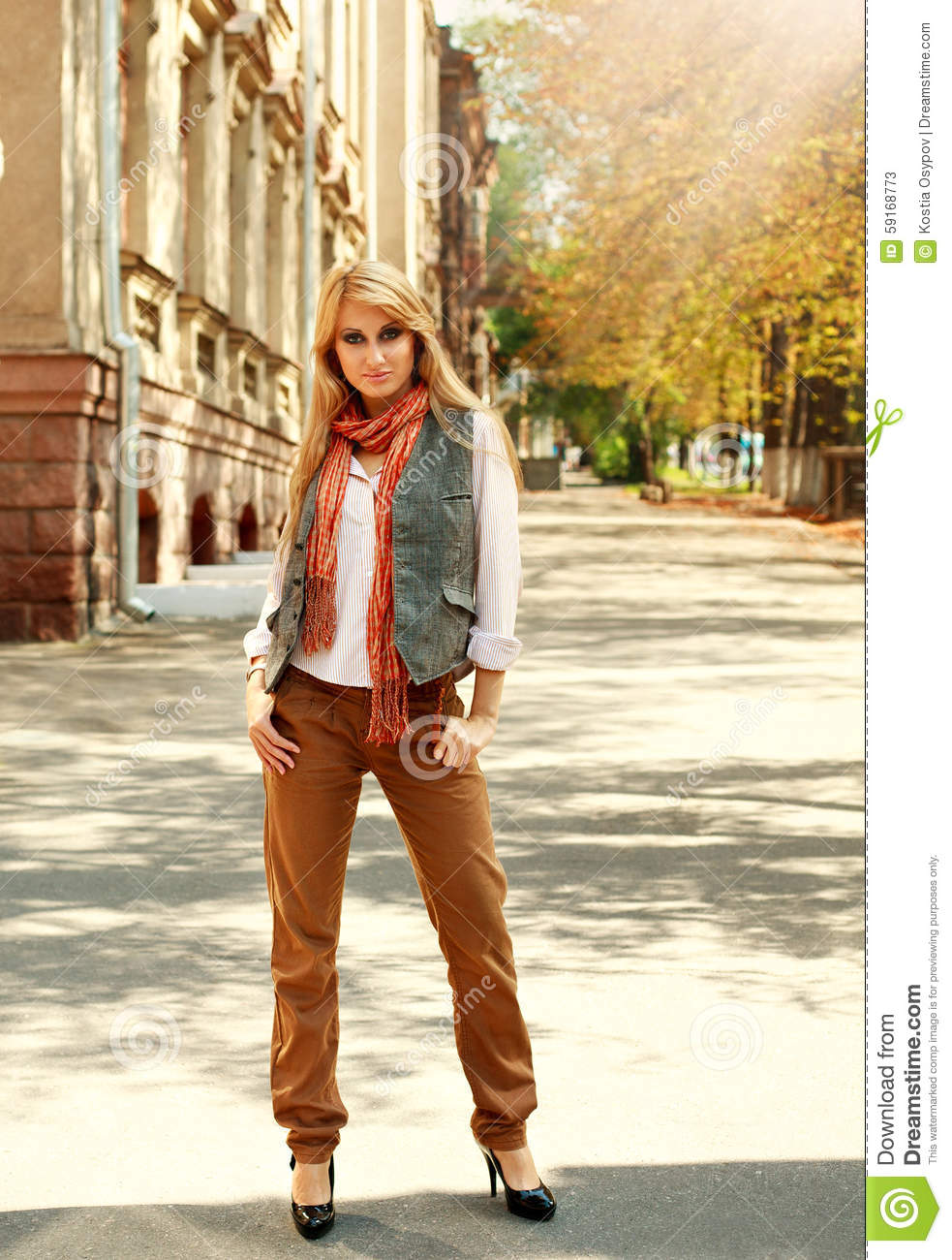 Fashion Woman In Retro Style On A City Street In Autumn