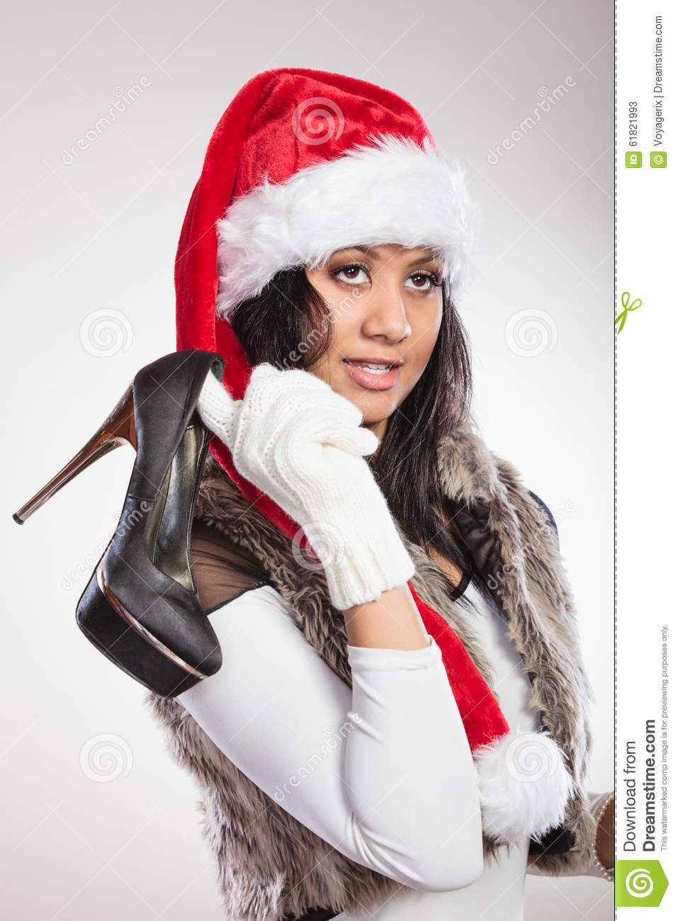 Fashion woman in santa hat with high heels shoes stock