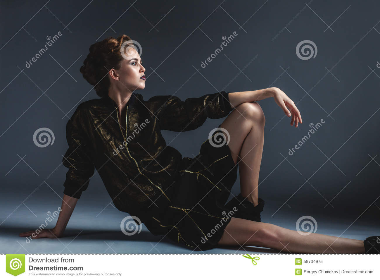 Fashion woman sitting on the floor in an elegant pose for On the floor