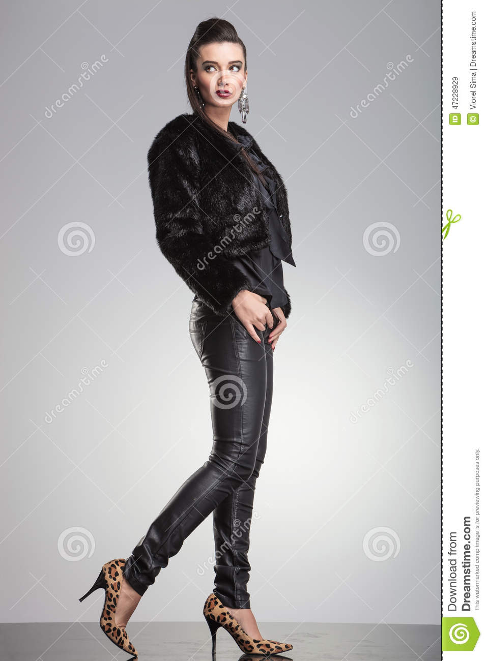 Fashion Woman Stepping Forward While Looking Up Stock ...