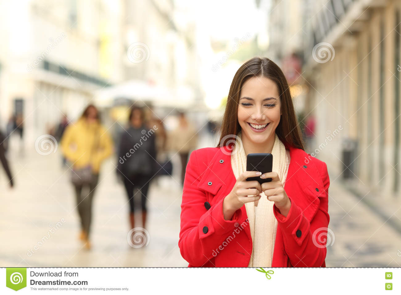 Fashion woman using a smartphone in winter