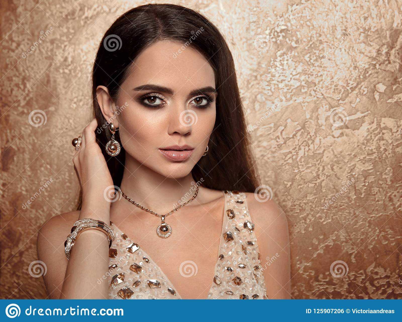 4955d53e7e1 Fashion woman golden set of jewelry. Necklace, earrings and bracelet. Beauty  and accessories. Elegant lady in gold with professional makeup, long  healthy ...