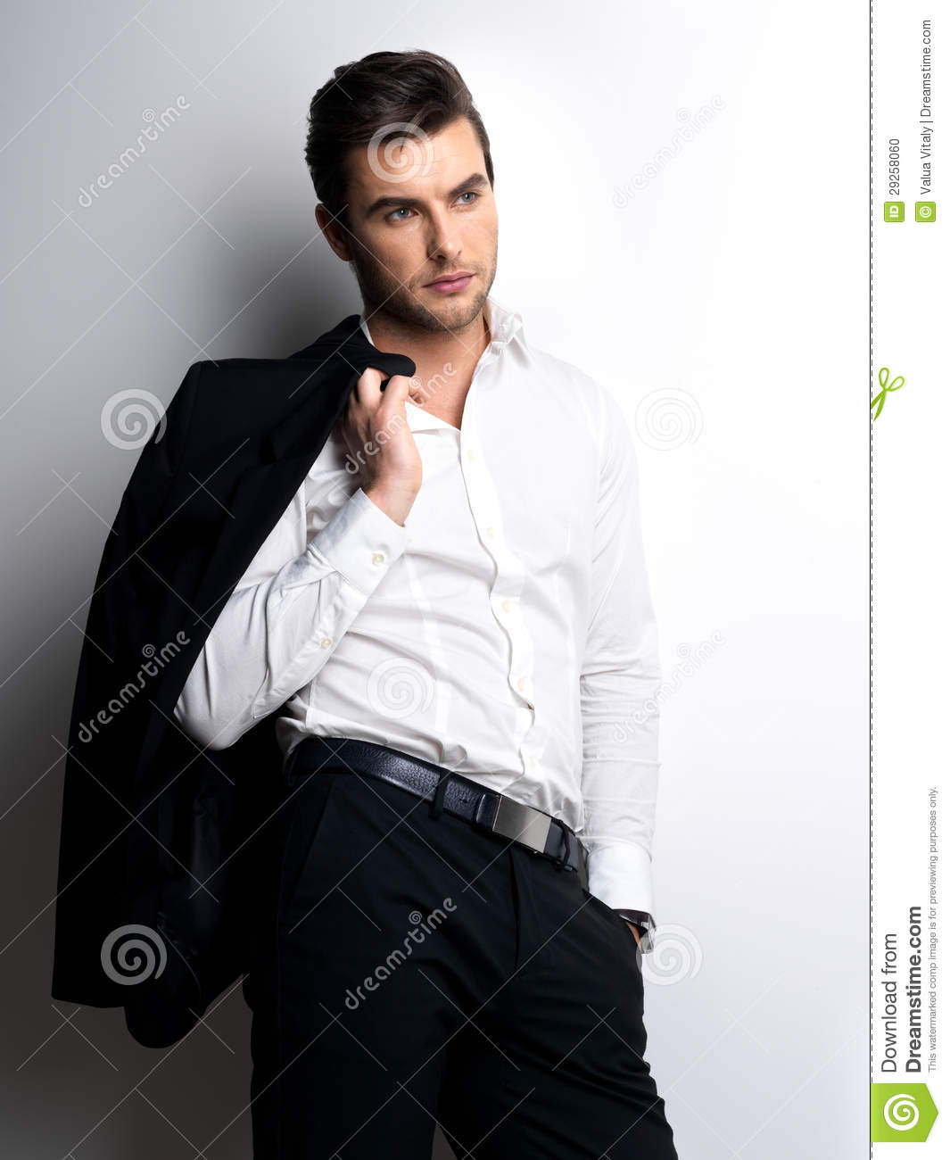 Fashion Young Man In White Shirt Holds The Black J Stock Photo ...