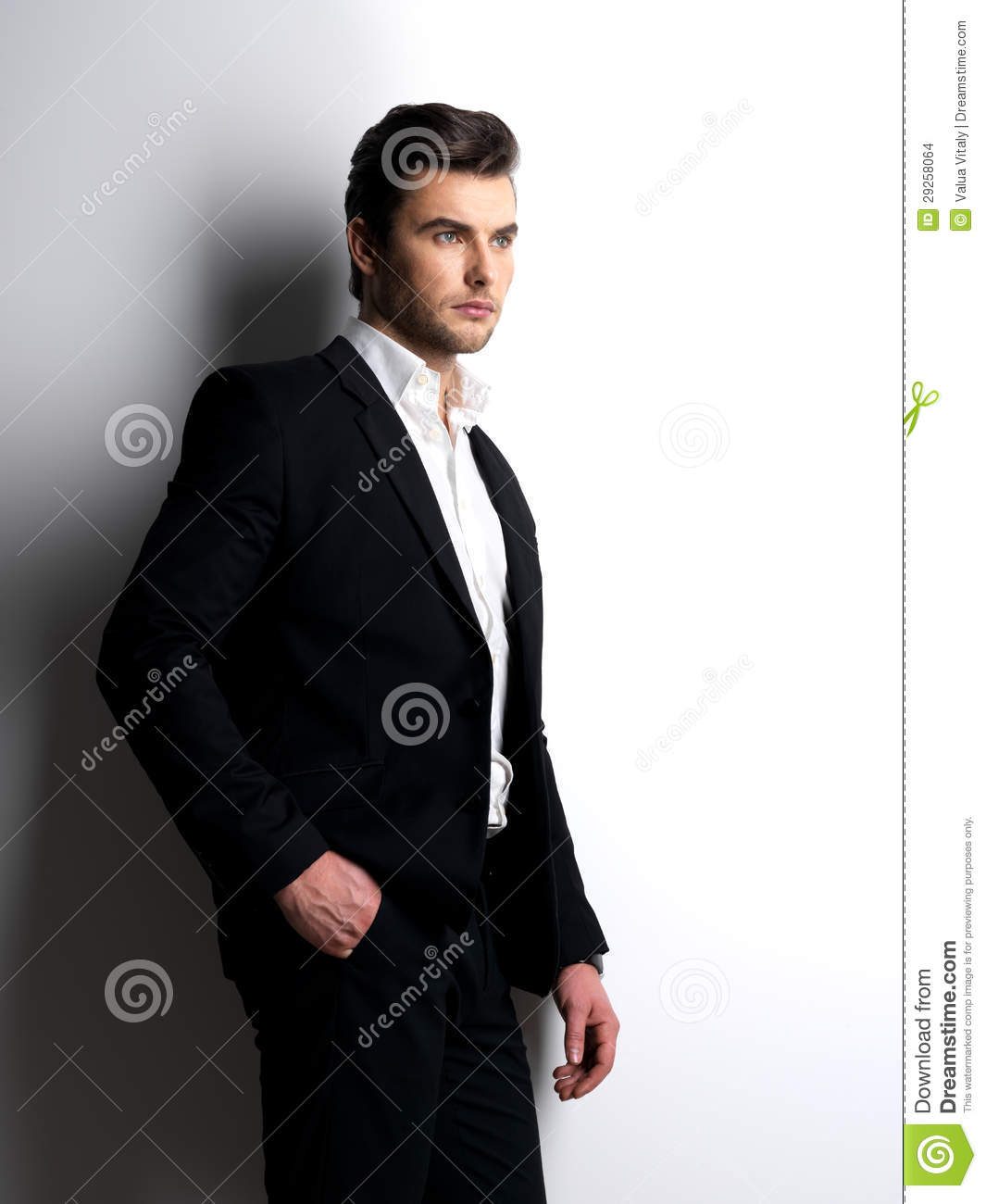 Fashion Young Man In White Shirt Holds The Black Jacket Stock ...