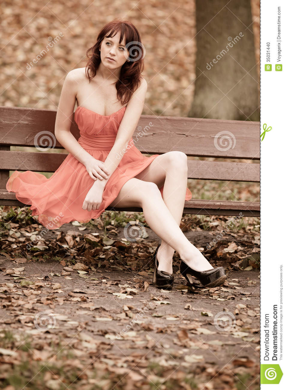 Fashion Young Woman In Red Dress Relaxing In Park On Bench Stock Photo Image 35031440