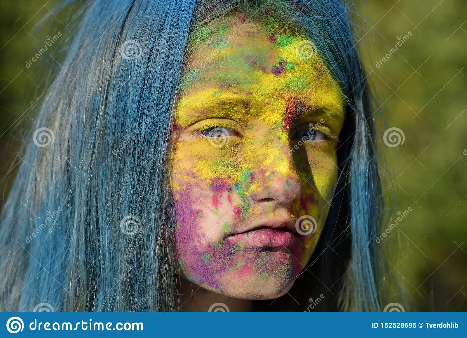 Fashion youth party. Optimist. Spring vibes. Crazy hipster girl. Summer weather. colorful neon paint makeup. child with