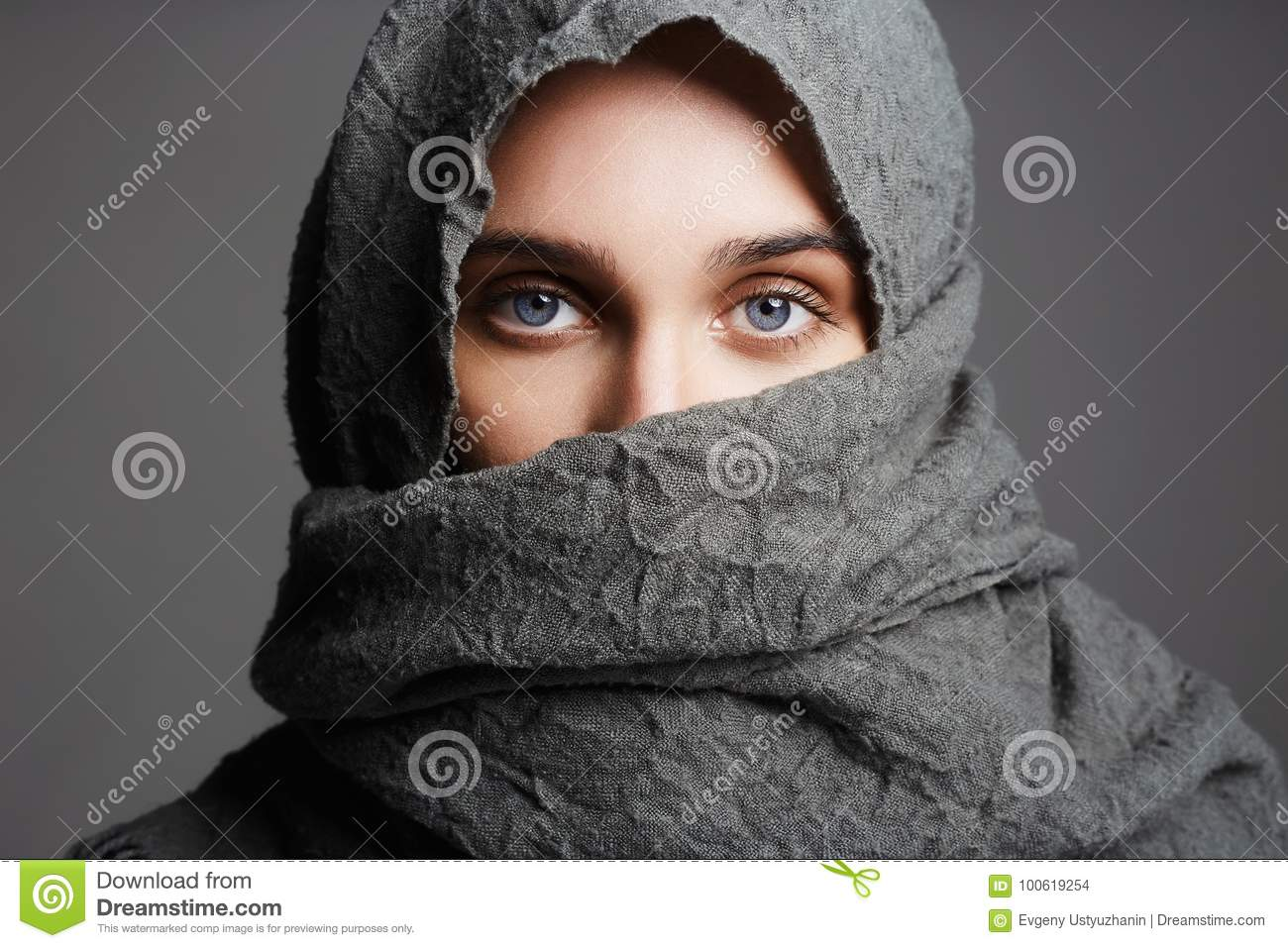 525ec2ab3c9 Beautiful woman covers her face with hi jab.fashionable arabian style girl. beauty portrait