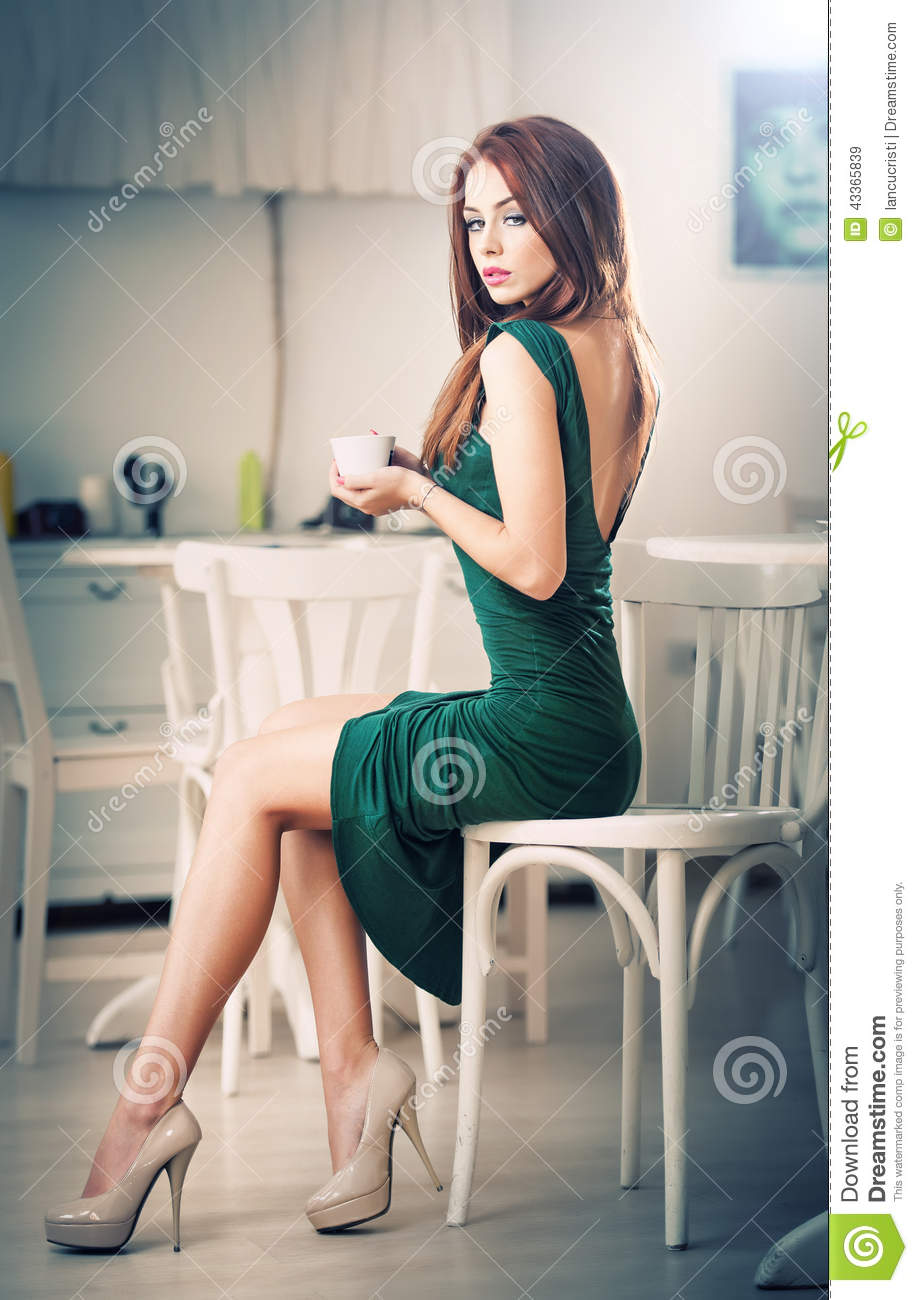 Download Fashionable Attractive Young Woman In Green Dress Sitting In Restaurant. Beautiful Redhead In Elegant Scenery With A Cup Of Coffee Stock Image - Image of caucasian, female: 43365839