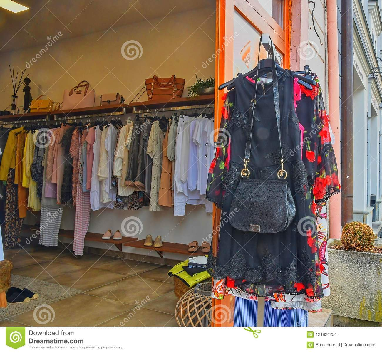 b8ee16abea9 Fashionable clothes in a boutique store. Clothing on hanger at the modern shop  boutique. Selective focus.