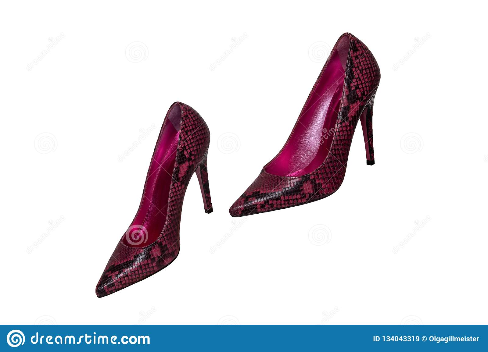 Fashionable female high heels. A pair of purple high-heeled female shoes isolated on a white background. Shoes from snakeskin
