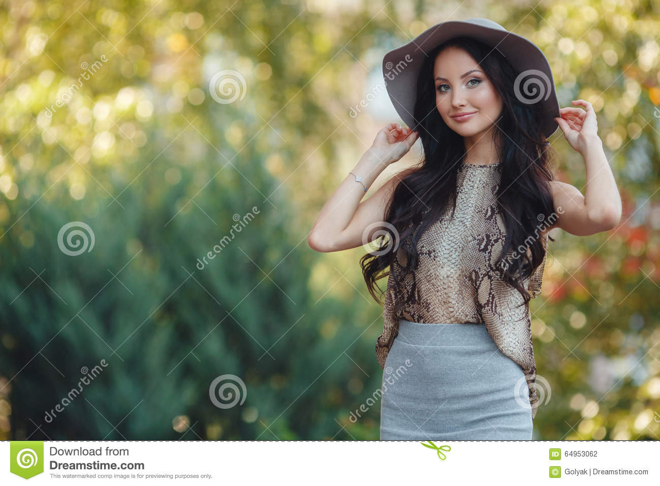Fashionable girl in hat outdoor. Summer portrait of a beautiful woman with  long black hair b4ccd40c5afb
