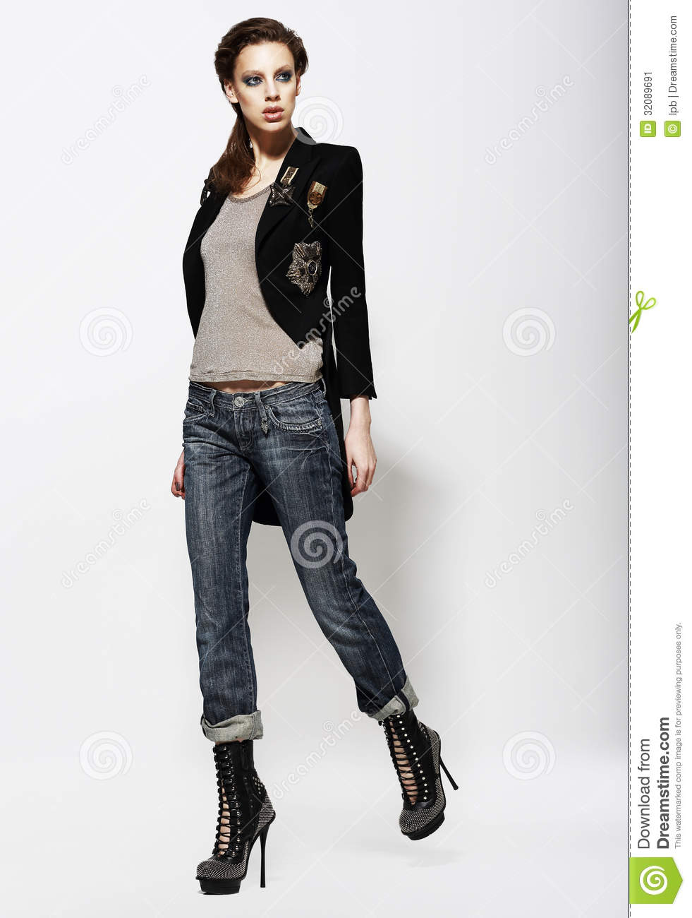 Fashionable Glamorous Woman In Jeans And High Boots Vogue