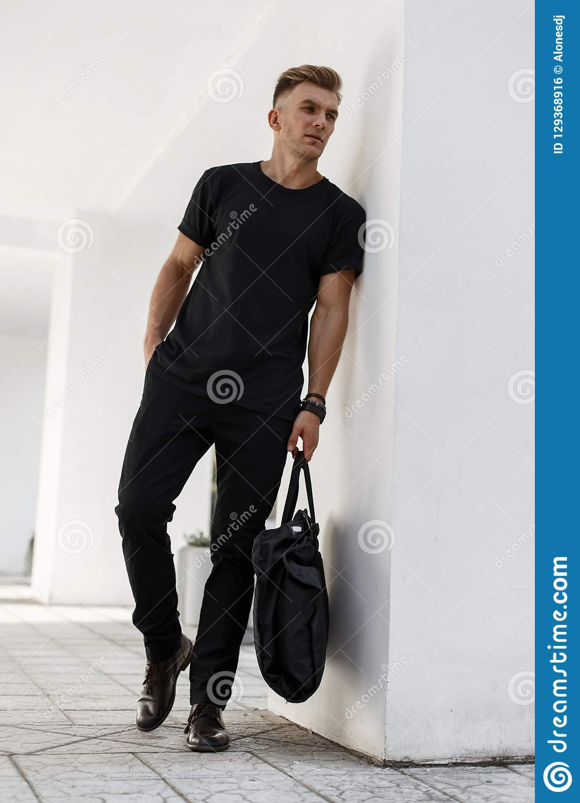 Fashionable Handsome Young Man In Black Stylish Clothes With