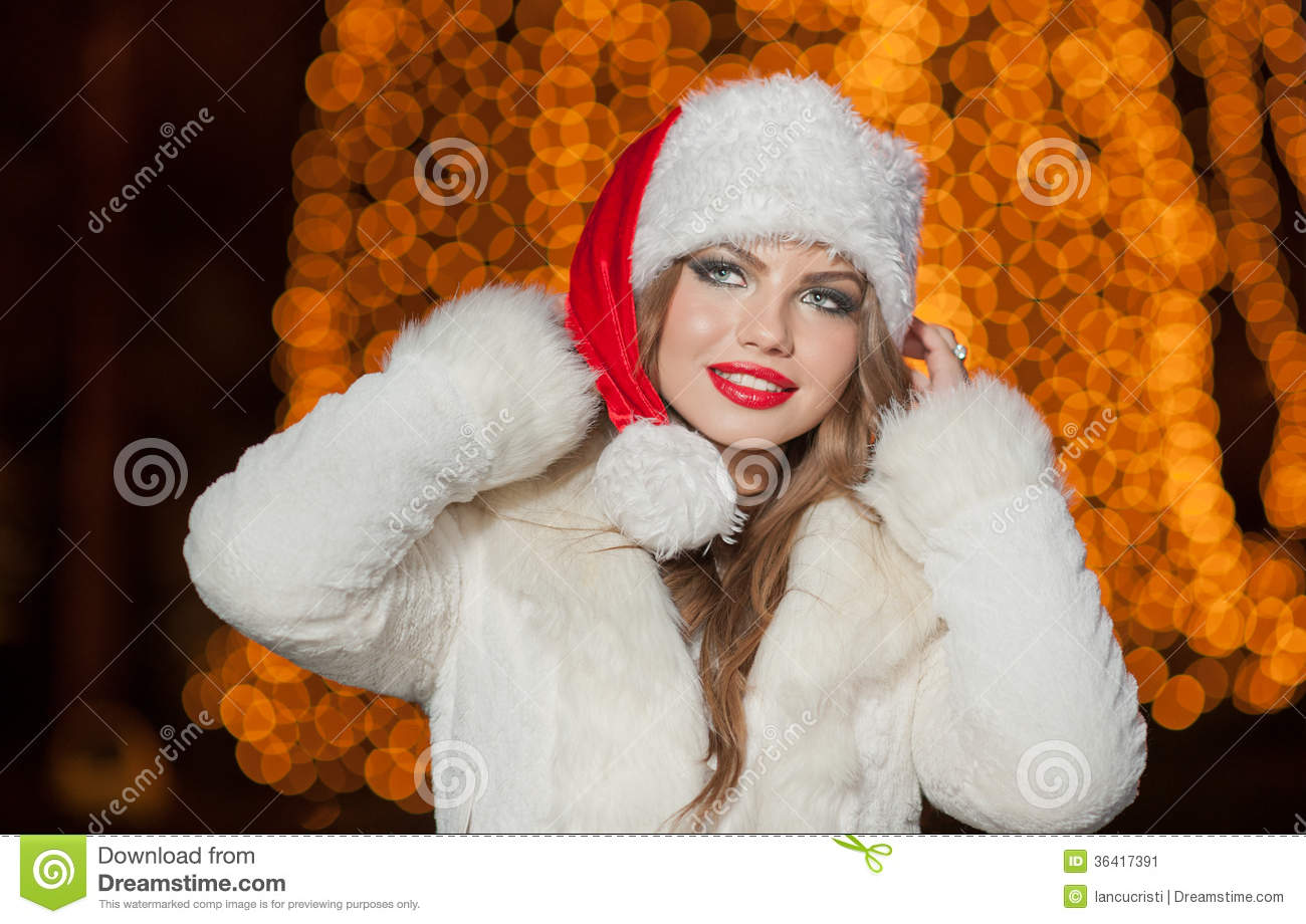 e2753d8920d8 Fashionable Lady Wearing Xmas Hat And White Fur Coat Outdoor ...