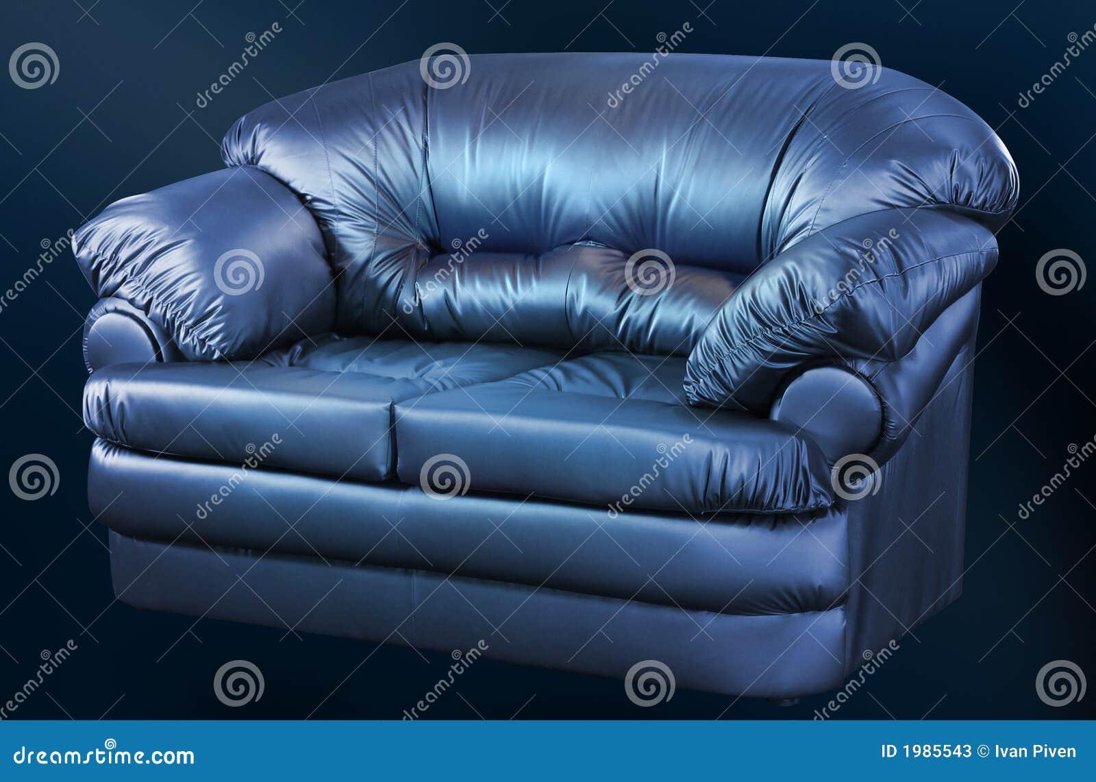 Fashionable Leather Sofa On A Black Background Stock Image