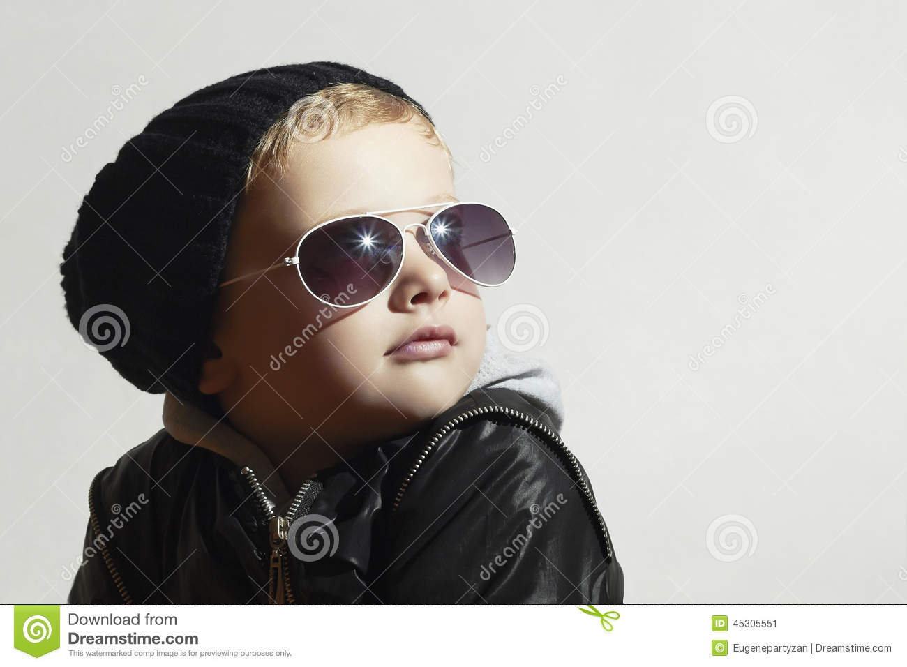 ... boy in sunglasses.Child.Winter style.Kids fashion.Little model in