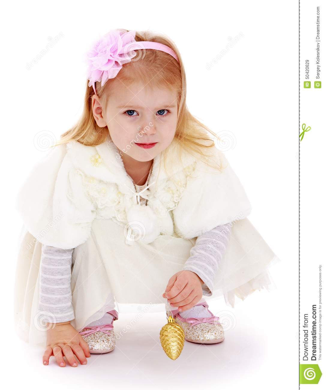 fashionable little girl with christmas toy in hand stock