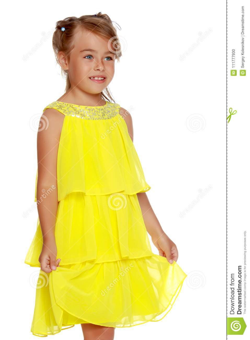 Fashionable little girl in a dress