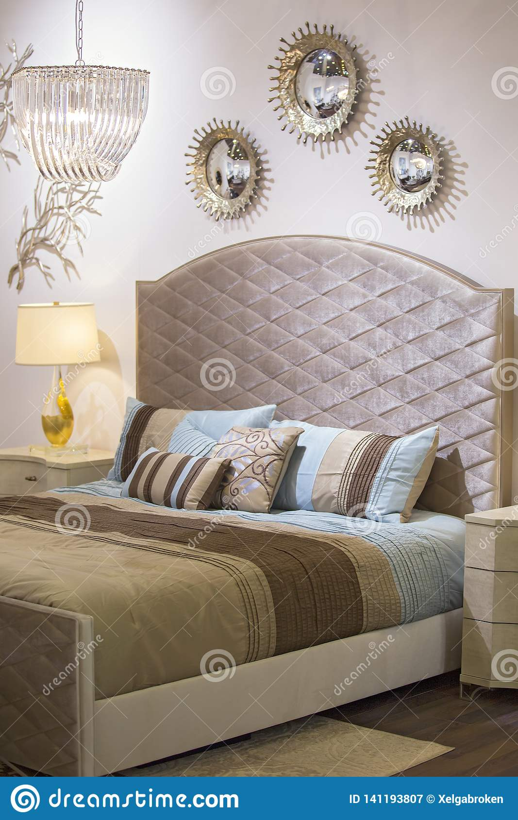 Picture of: Fashionable Modern Bedroom Bed Chandelier Mirrors On The Wall Bedside Table And Lamp Beautiful Textiles On The Bed Chic Stock Image Image Of Architecture Luxurious 141193807