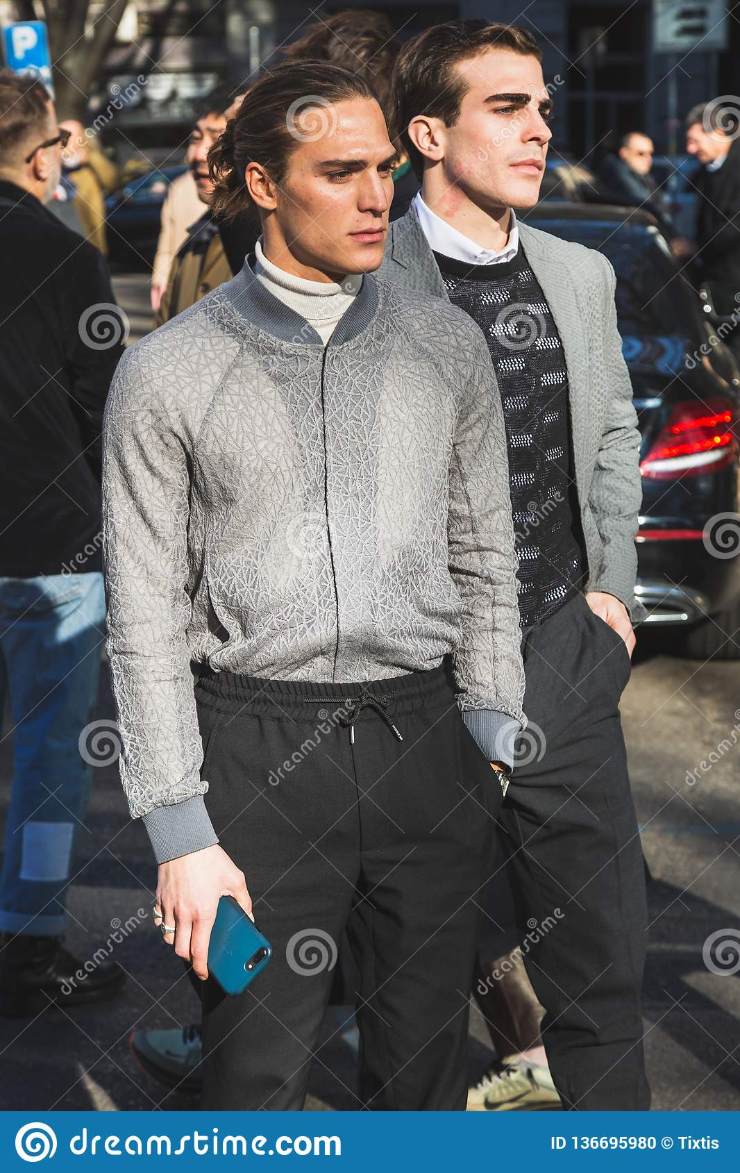 Fashionable people posing during Milan Men`s Fashion Week