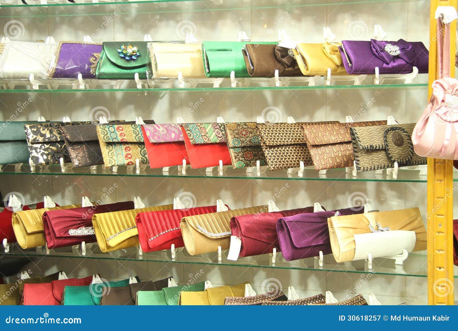 fashionable shiny handbags on showroom royalty free stock. Black Bedroom Furniture Sets. Home Design Ideas