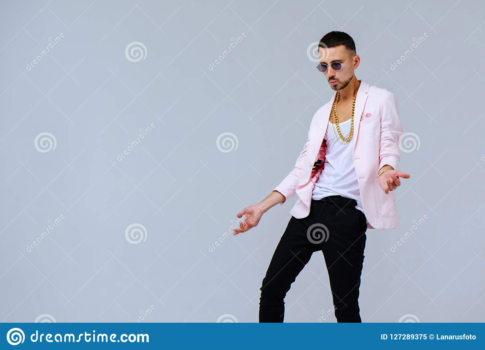 Fashionable Sophisticated Man In A Pink Jacket And Black Trousers