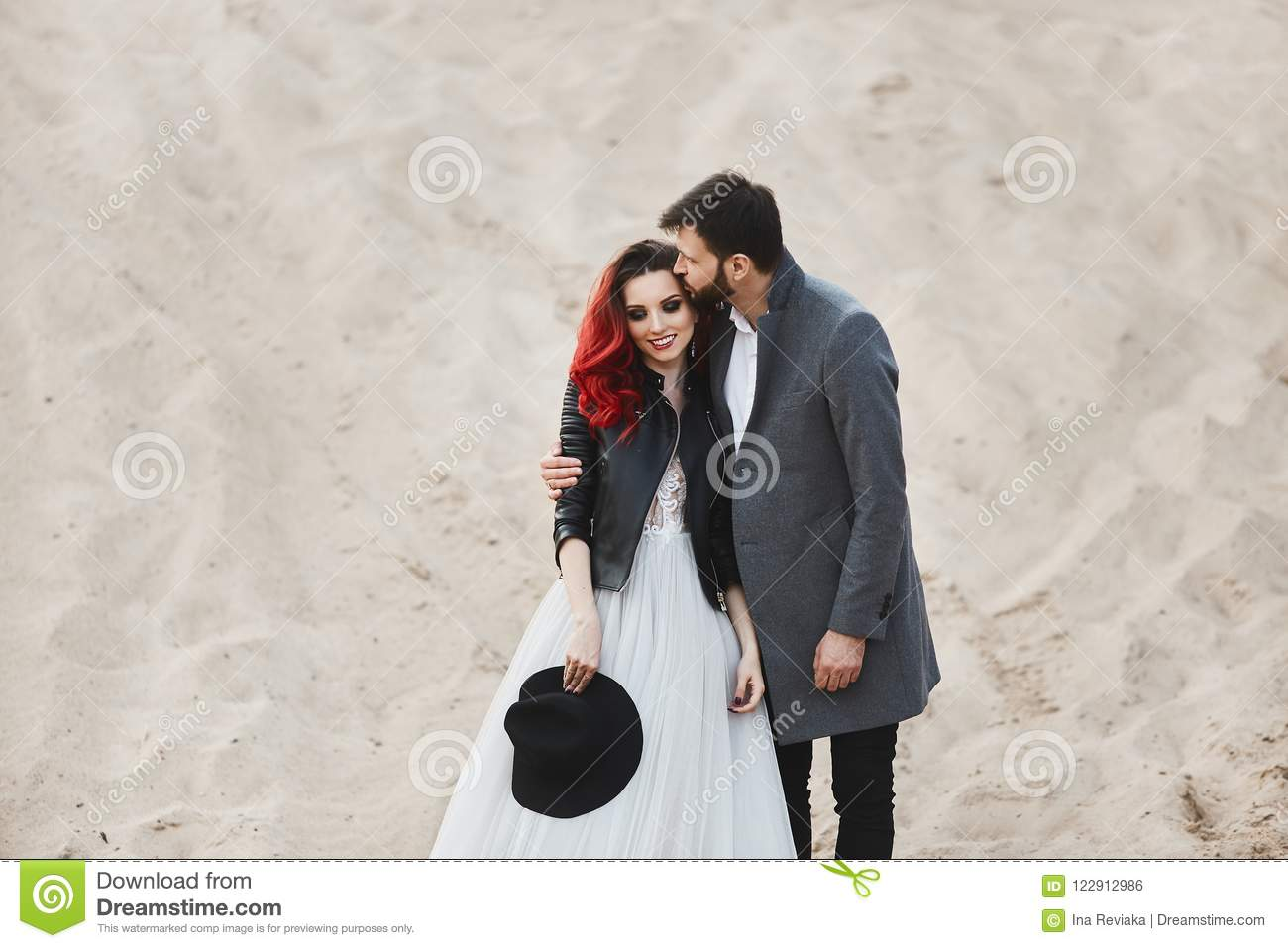 Fashionable And Stylish Couple Model Girl With Red Hair And