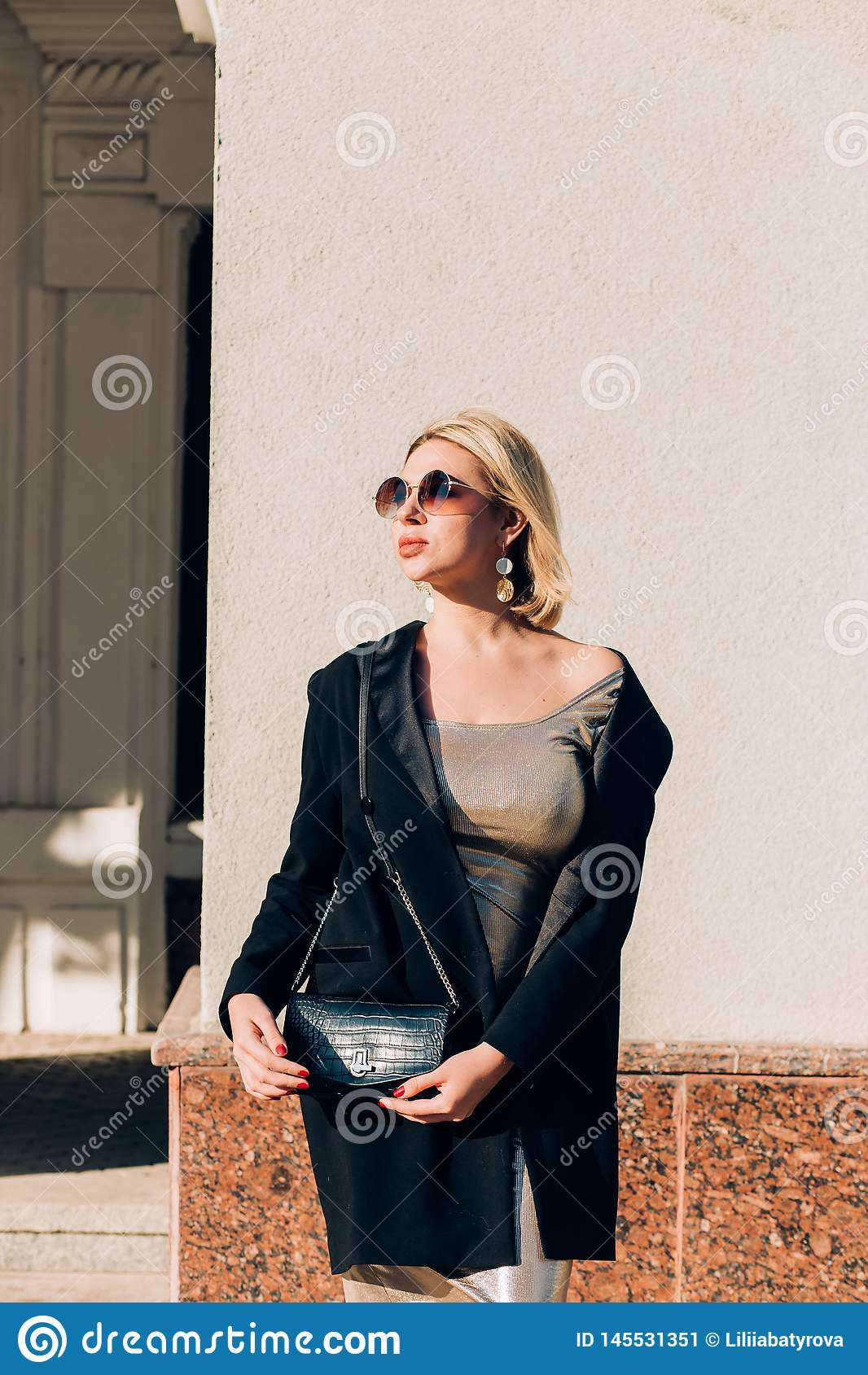 Fashionable woman on city street