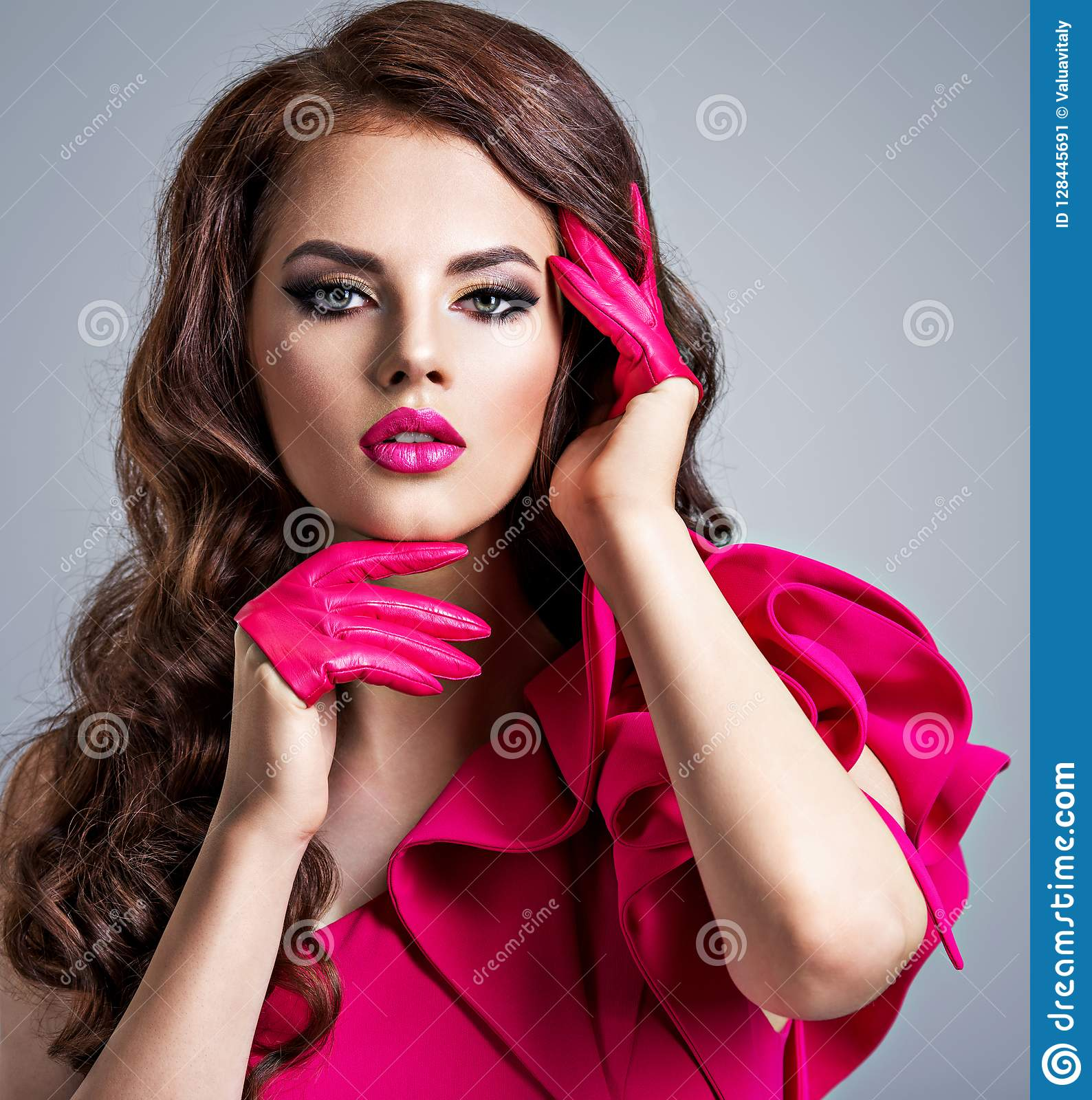 Fashionable Woman In A Red Dress With A Creative Eye Makeup Stock