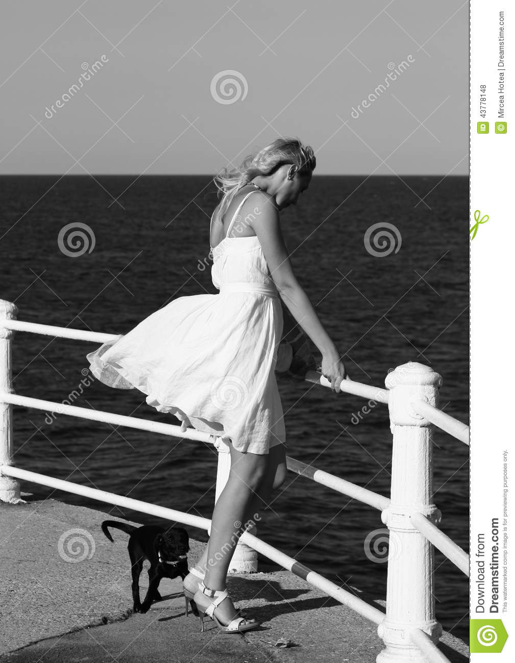 Fashionable woman by sea