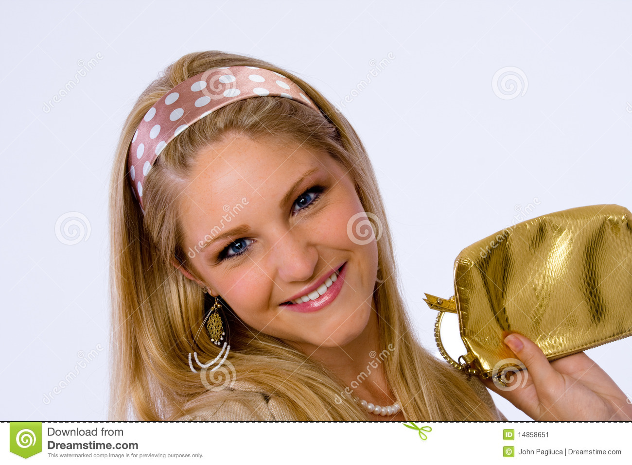 Fashionable young woman smiles at camera.