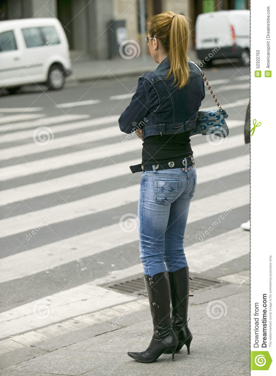 Fashionably Dressed Woman In Black Boots With High Heels And Tight ...