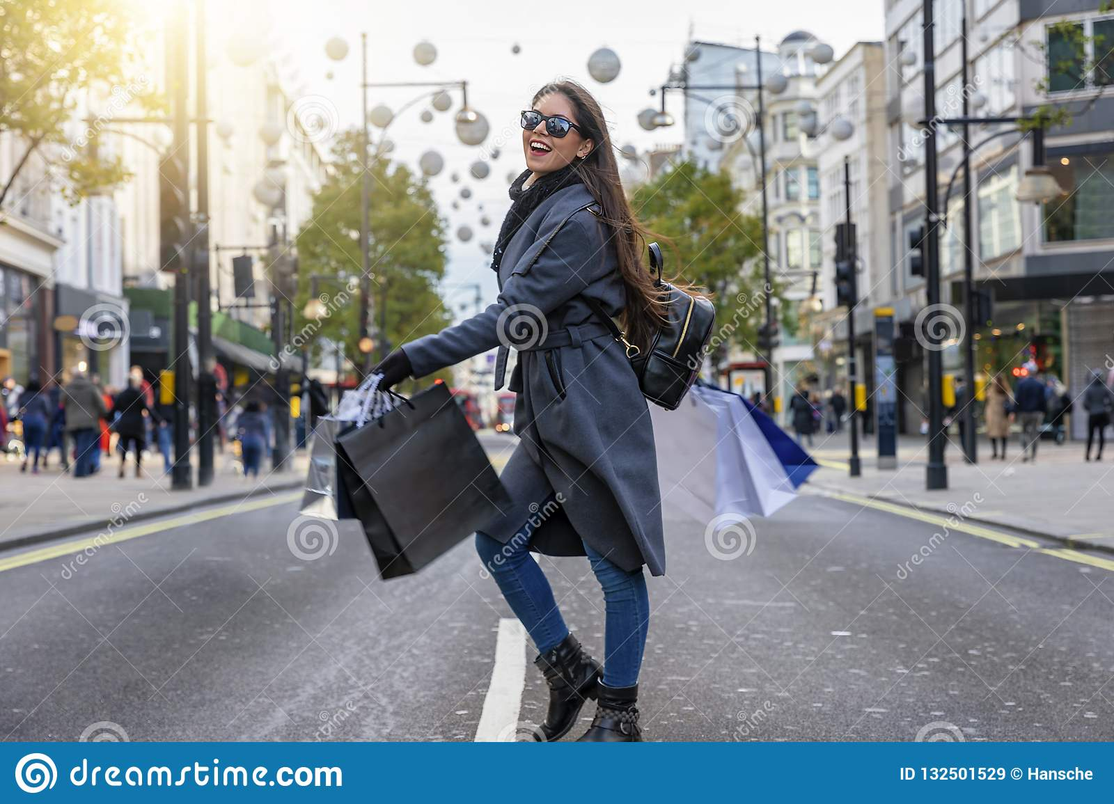 Fashionista woman on a shopping tour at the Oxford Street in London