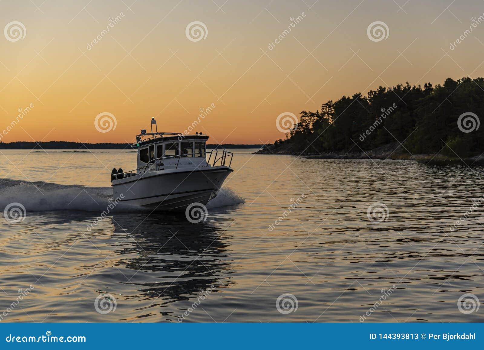 Fast cabin motorboat evening light Stockholm archipelago