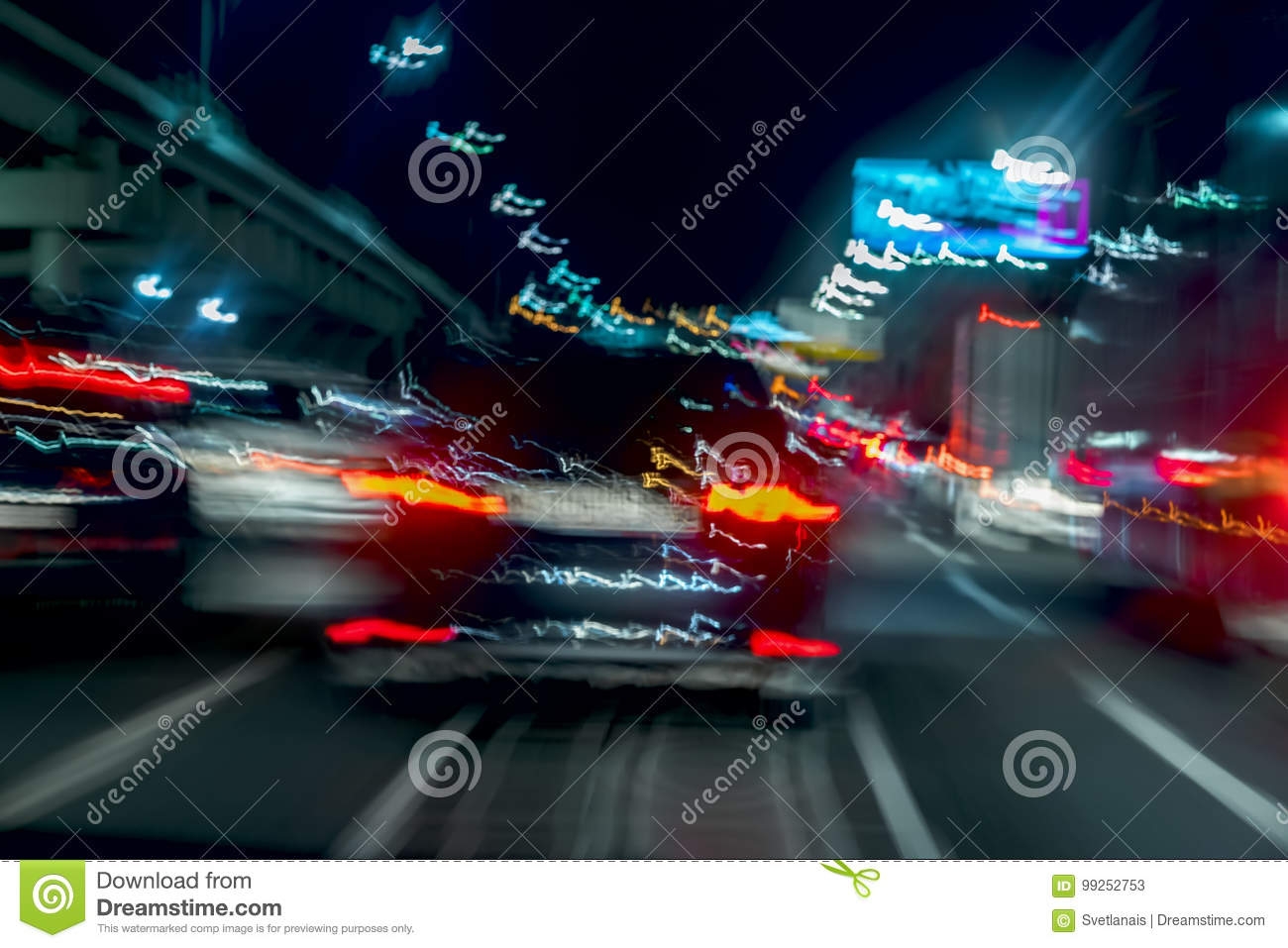 Fast driving traffic at night, blue colors. Abstract blurred background of urban moving car with bright brake lights at